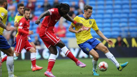 Striker Kenwyne Jones scores his second goal of the season to give Cardiff a 2-0 interval lead over Huddersfield Town.