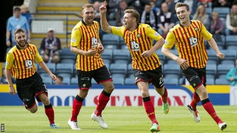 Partick Thistle ace Gary Fraser (2nd right) celebrates after giving his side the lead against Dundee.