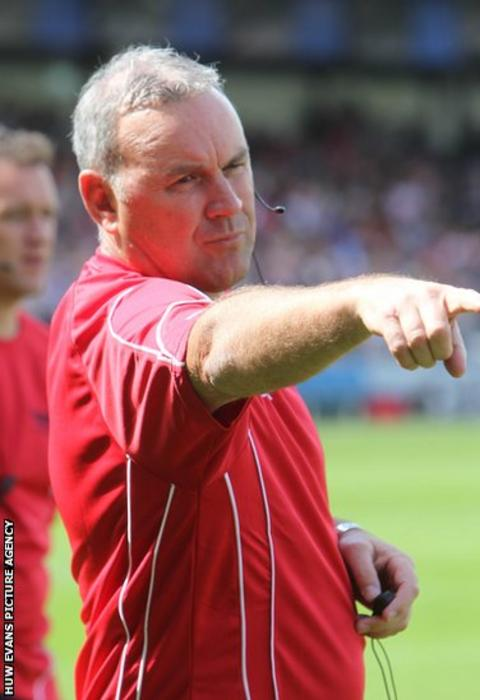 New Scarlets head coach Wayne Pivac gives instructions during his side's pre-season friendly against Bath.