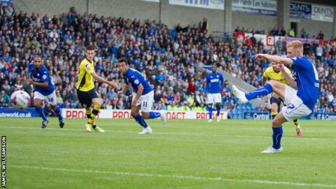 Chesterfield striker Eoin Doyle scores one of his two penalties against Rochdale