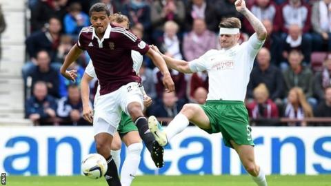 Hearts striker Osman Sow and Hibs defender Michael Nelson