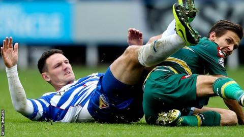 Sean Morrison goes in for a tackle