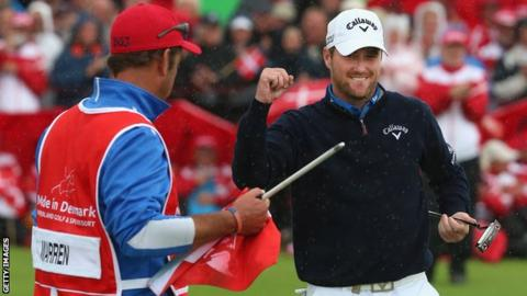 Marc Warren celebrates with his caddie in Denmark