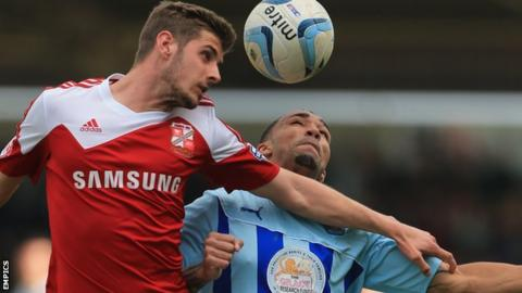 Jack Stephens playing for Swindon Town