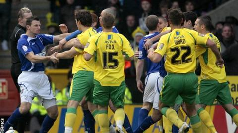 Norwich City and Ipswich Town players tussle