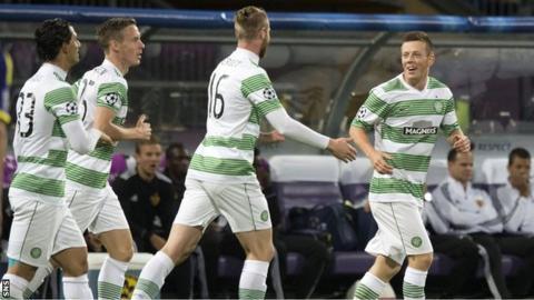 Callum McGregor is congratulated on his goal for Celtic in Slovenia