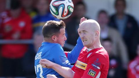 Midfielders Shane McCabe and Ryan Catney challenge for the ball during the 3-3 draw at Solitude