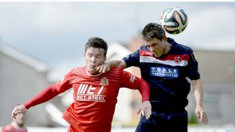 Peter McMahon and Craig McClean in action as the Ports emerge 3-1 victors over the Crues at Shamrock Park