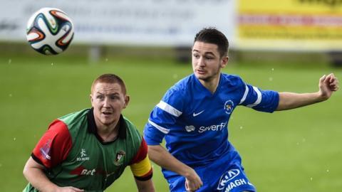 Glentoran's Stephen McAlorum and Ballinamallard's Liam Martin keep their eyes on the ball at Ferney Park