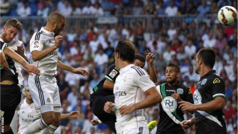 Real Madrid striker Karim Benzema heads in the opener