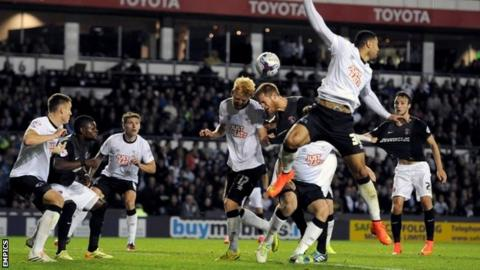 Derby County's Zak Whitbread (centre left) and Charlton Athletic's Michael Morrison (centre right) battle for the ball