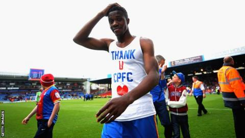 Wilfried Zaha with T-shirt thanking Crystal Palace