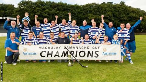 Newtonmore celebrate with the MacAulay Cup