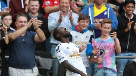 Dyer celebrates after scoring his second goal of the afternoon to seal an impressive 3-0 win over West Brom.