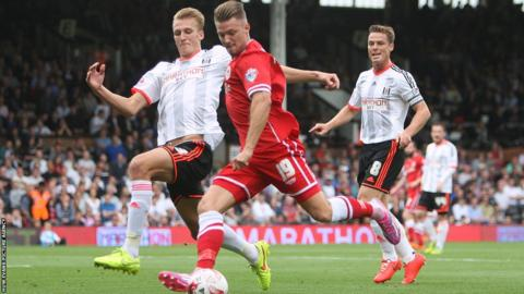 Anthony Pilkington has a shot on goal during Cardiff City's Championship game at Fulham.