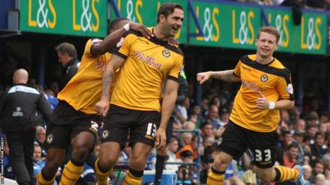 Andy Sandell celebrates with team mates Ryan Jackson and Mark Byrne after scoring Newport County's winning goal against Portsmouth.