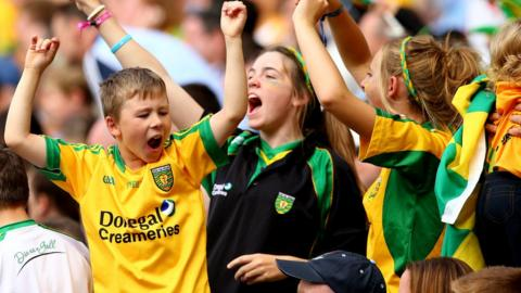 Young Donegal supporters celebrate after their county books a place in the All-Ireland final against Kerry on 21 September