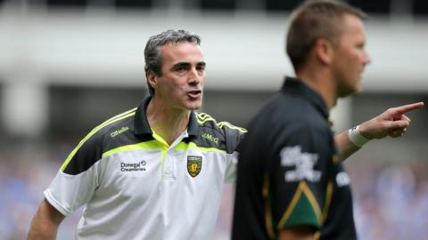 Donegal manager Jim McGuinness makes a point to linesman Rory Hickey on the sideline
