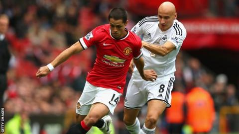 Jonjo Shelvey challenges Javier Hernandez during Swansea's Premier League opening day win at Manchester United