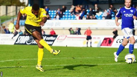 Myles Hippolyte scores for Livingston against Peterhead