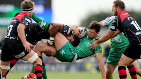 Aled Brew of the Draons tackles Connacht's Danie Poolman