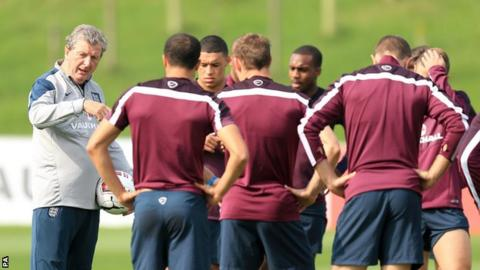 England manager Roy Hodgson (left) talks to his players