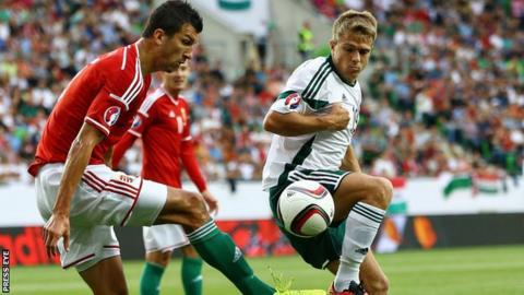 Hungary's Zoltan Liptak competes against Jamie Ward of Northern Ireland