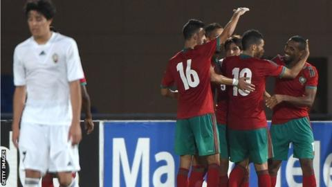 Morocco celebrate a goal against Qatar