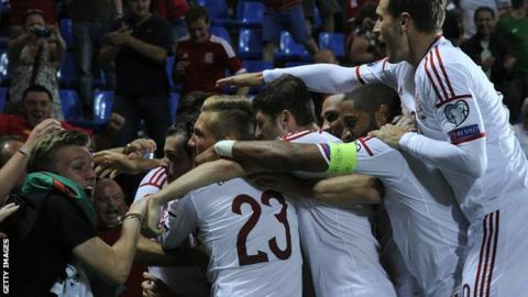 Wales celebrate the first goal