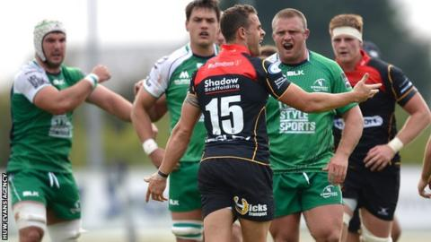 Lee Byrne is confronted by Connacht players