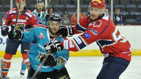 Darryl Lloyd of the Belfast Giants in action against Kyle Fleming of the Edinburgh Capitals
