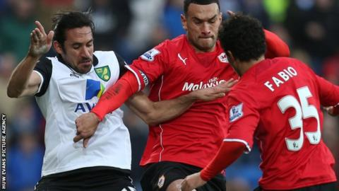 Steven Caulker and Jonas Gutierrez battle for the ball