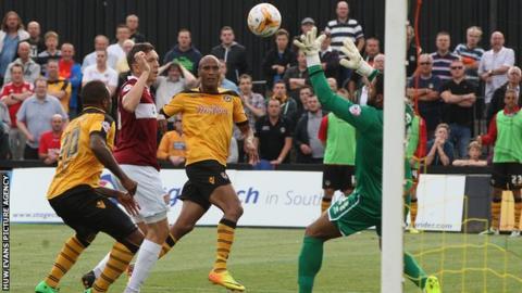 Chris Zebroski scores Newport's opening goal against Northampton