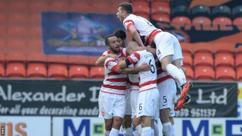 Hamilton's Tony Andreu (hidden) celebrates his goal against Dundee United.