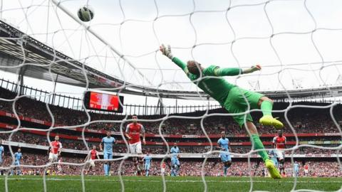 Alex Sanchez puts Arsenal ahead as he fires past Manchester City keeper Joe Hart