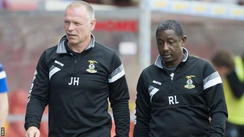 Inverness manager John Hughes and his assistant Russell Latapy
