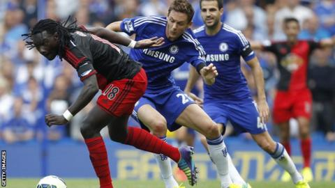 Swansea striker Bafetimbi Gomis vies with Chelsea midfielder Nemanja Matic