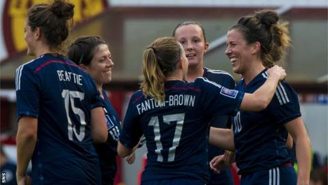 Leanne Crichton (right) is hailed by her team-mates after making it 7-0 to Scotland