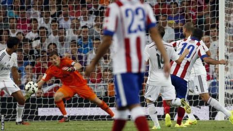 Atletico Madrid's Arda Turan scores