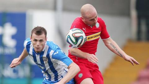 Darren McCauley and Barry Johnston in aerial action during Coleraine's game against Cliftonville