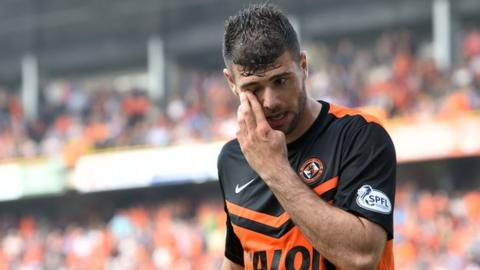 Dundee United's Nadir Ciftci is sent off after a second yellow for handling the ball.