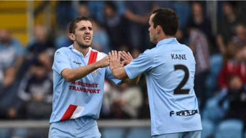 Gary Thompson celebrates with fellow Ballymena substitute Tony Kane after scoring a late equaliser