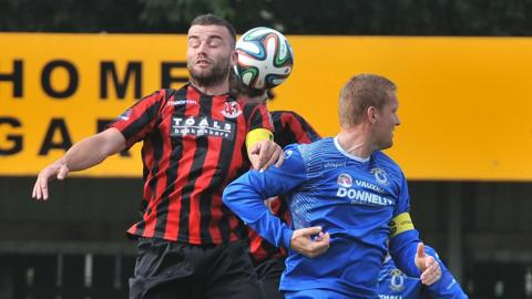 Colin Coates and David Armstrong in action as Crusaders recover from two goals down to draw 2-2 with Dungannon Swifts