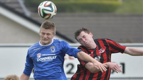Andrew Mitchell and Billy Joe Burns show their determination during the game at Stangmore Park