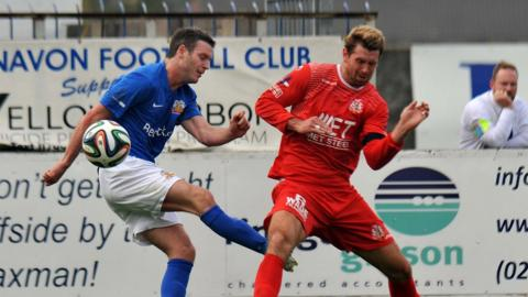 Kevin Braniff and Garry Breen vie for possession in an eventful Mid-Ulster derby at Mourneview Park