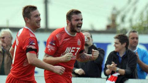 Mark McAllister congratulates Darren Murray after the striker put his side into a 3-1 lead at Shamrock Park