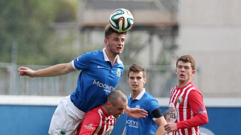 Chris Hegarty rises highest to clear the danger during Linfield's 1-0 victory over Warrenpoint Town