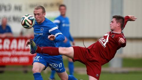 Ballinamallard United's Raymond Foy challenges Michael McCrudden of Institute at Ferney Park
