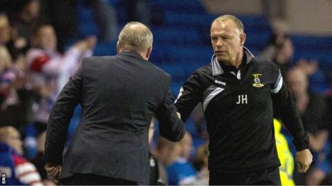 Inverness CT manager John Hughes shakes hands with Rangers boss Ally McCoist