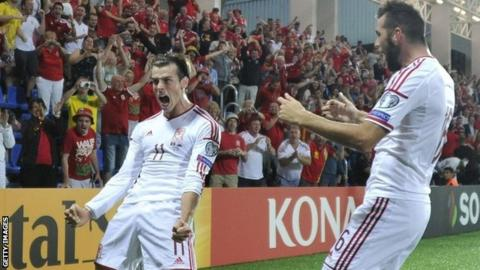 Gareth Bale celebrates with team-mate Joe Ledley after scoring against Andorra
